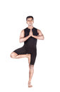 Yoga tree pose on white by indian man in black costume mudra isolated at background Royalty Free Stock Photos