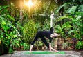 image photo : Yoga in the tropic garden