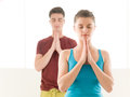 Yoga welcome handsome men and beautiful women in a clean white gym Royalty Free Stock Image