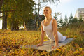 Yoga woman on autumn park background Royalty Free Stock Photo