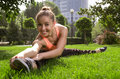 Yoga woman beautiful young doing stretching exercise on green grass at park Stock Image