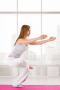 Yoga woman girl practicing on the pink background of skyscraper Royalty Free Stock Photos