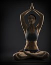 Yoga woman meditate sitting in lotus pose silhoue silhouette of exercise girl over black background Stock Image