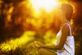 Yoga woman meditating at sunset Royalty Free Stock Photo