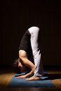 Yoga woman practising her strength and balance healthy lifestyle fitness sport exercise Stock Image