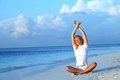 Yoga woman on sea coast Royalty Free Stock Photo