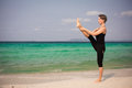 Yoga woman on the sea posture utthita hasta padangusthasana feb Royalty Free Stock Photography