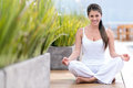 Yoga woman sitting on the floor and smiling outdoors Stock Photography