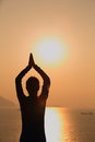 Yoga woman sunrise at the seaside Stock Image