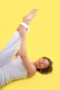 Yoga woman woman isolated on yellow background doing with a Royalty Free Stock Image