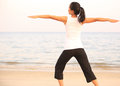 Yoga woman young healthy seaside Stock Photo