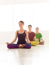 Yoga worhshop three young people a women and two men practice class stand in line Stock Image