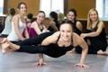 Yogi girl exercising, doing ashtavakrasana, handstand push-ups Royalty Free Stock Photo
