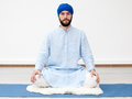 Yogi man sitting on the mat Royalty Free Stock Photo