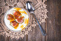 Yogurt with figs and honey greek in a glass bowl over old lace tablecloth Royalty Free Stock Image