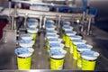 Yogurt filling and sealing machine Royalty Free Stock Photo