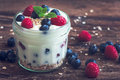 Yogurt with Fresh Berries on Woden Table Royalty Free Stock Photo