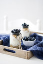 Yogurt with fresh blueberries and cereals on tray Royalty Free Stock Photo