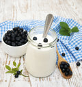 Yogurt fresh with blueberries in glass jar Stock Photos