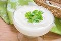 Yogurt with leaf in glass