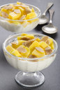 Yogurt with mango and roasted almond sliver cube in a glass bowl Royalty Free Stock Photo