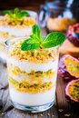 Yogurt parfait with granola, peach sauce and passion fruit with mint Royalty Free Stock Photo
