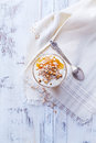 Yogurt with peach jam walnuts and rye flakes in a glass from above Royalty Free Stock Photos