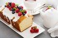 Yogurt pound cake with glaze and fresh berries for breakfast Stock Photo