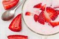 Yogurt strawberry bowl spoon Royalty Free Stock Photos