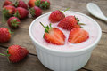 Yogurt with strawberry in bowl Royalty Free Stock Photo