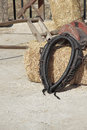 Yoke black leather over a hay bale Royalty Free Stock Photos
