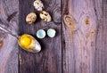 Yolk quail eggs in an iron spoon