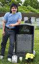 Yomo toro grave queens new york june nephew eddie visits of master of the puerto rican guitar like instrument called a cuatro Royalty Free Stock Images