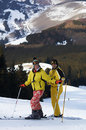 Yong family skiers on ski slope Royalty Free Stock Images