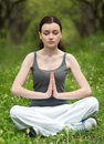 Yong girl doing yoga meditation in the park Royalty Free Stock Image