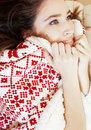 Yong pretty brunette girl in Christmas ornament blanket getting warm on cold winter, freshness beauty concept Royalty Free Stock Photo