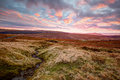Yorkshire dales at sunset view across moorland to the pennines in the the distinctive plateaued peak of ingleborough one of the Stock Images