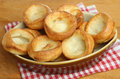 Yorkshire puddings in serving dish Stock Images