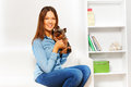 Yorkshire terrier with smiling woman holding him cute small brown hands indoors Stock Photos