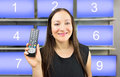 You can choose your favourite channel closeup of a woman holding a remote control with numbers in background Royalty Free Stock Photo
