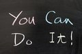 You can do it words written on chalkboard Stock Photo