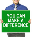 You can make a difference man in office attire holding sign with motivational message Royalty Free Stock Photography
