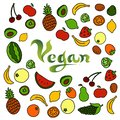 Doodle background with different fruits surrounding the word Vegan Royalty Free Stock Photo