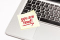 You are fired written on sticky note on laptop keyboard Royalty Free Stock Photography