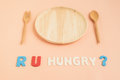 Are you hungry text with wooden plate and cutlery Royalty Free Stock Photo