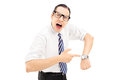 You are late angry man shouting and pointing on a wrist watch isolated against white background Royalty Free Stock Photos
