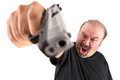 You made him angry big man with goatee points his gun to your chest looks very make sure do whatever he says stop thinking focus Royalty Free Stock Images