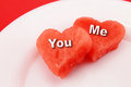 You and me red hearts conceptual image for san valentine s day with chunks of watermelon cut heart shaped presented on a plate Stock Images