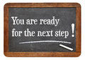You are for the next step motivational statement on a vintage slate blackboard Stock Photography