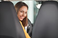 Are you ready to go attractive young woman sitting at the front seat of car looking camera Royalty Free Stock Photos